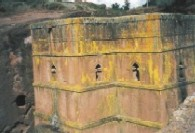Pictures of Saint George church, Bieta Medhane Alem church, priests holding crosses and the monastic complex of roch-hewn churches, Lalibela